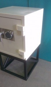 A commercial safe with a stand (raised base)